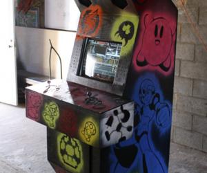 thumb arcade machine